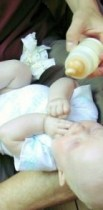 http://en.wikipedia.org/wiki/File:Infant_with_baby_bottle.jpg