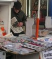 http://en.wikipedia.org/wiki/File:Newspaper_vendor.jpg