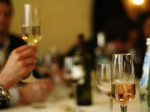 http://commons.wikimedia.org/wiki/File:Offering_a_toast_with_sparkling_wine_flutes.jpg