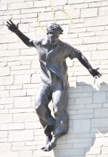 http://commons.wikimedia.org/wiki/File:Jesus-in-Jeans-by-Peter-Royle.jpg