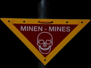 http://commons.wikimedia.org/wiki/File:Mines_warning_sign.jpg