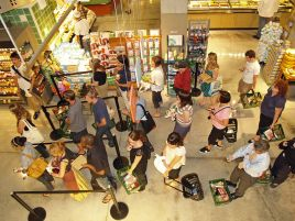 http://commons.wikimedia.org/wiki/File:Waiting_in_line_at_a_food_store.JPG