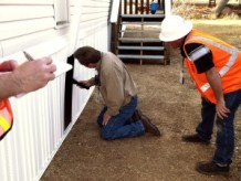 http://commons.wikimedia.org/wiki/File:FEMA_-_33788_-_County_building_inspector_at_a_FEMA_supplied_mobile_home_in_California.jpg
