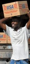 https://commons.wikimedia.org/wiki/File:US_Navy_080916-N-3595W-055_A_Port-au-Prince_citizen_carries_supplies_to_be_delivered_to_communities_affected_by_Hurricane_Ike.jpg