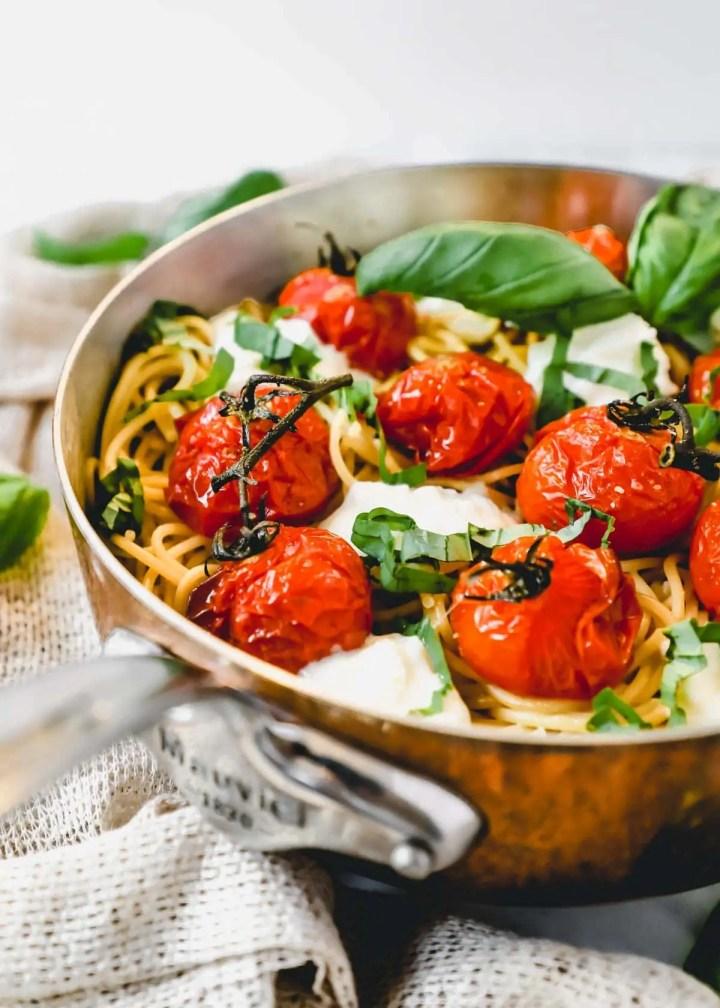 Roasted Tomato Burrata Spaghetti with basil.