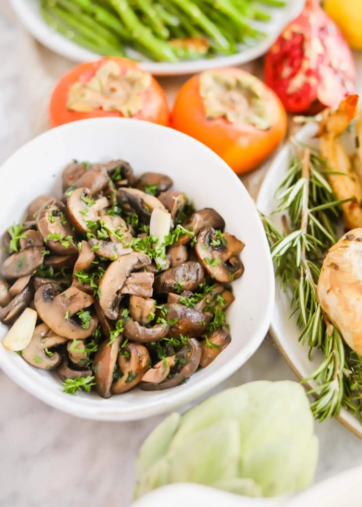Sautéed mushrooms with White Wine in white bowl.