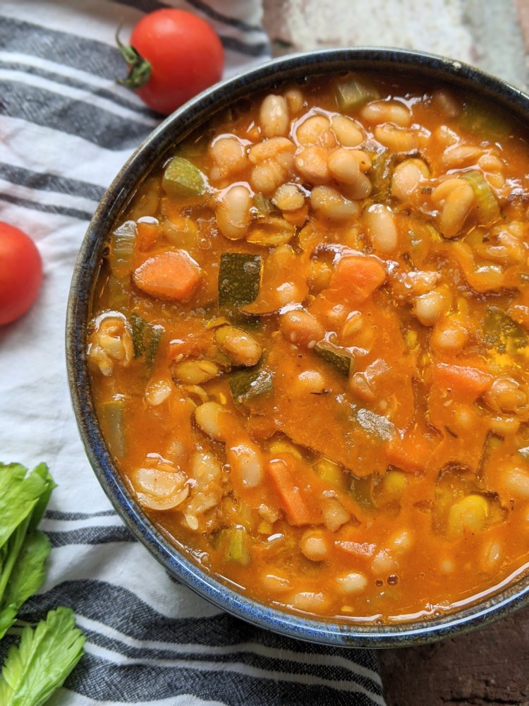 greek vegetable and bean soup recipe fasolatha fasolada soup vegan gluten free vegetarian classic greek soup creamy beans and veggies olive oil, tomatoes, carrots, celery, cumin, spices, garlic healthy homemade comfort food kids will love
