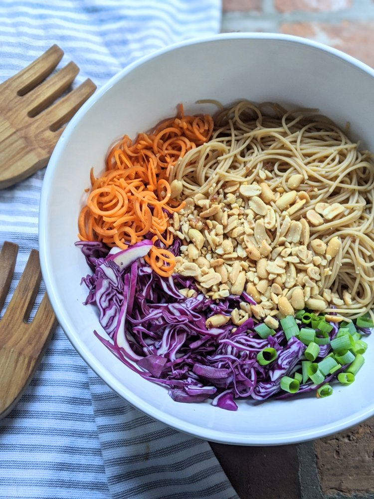 vegan peanut noodle salad recipe with carrots cabbage green onion peanut dressing gluten free vegetarian rice vinegar peanut butter tamari or soy sauce