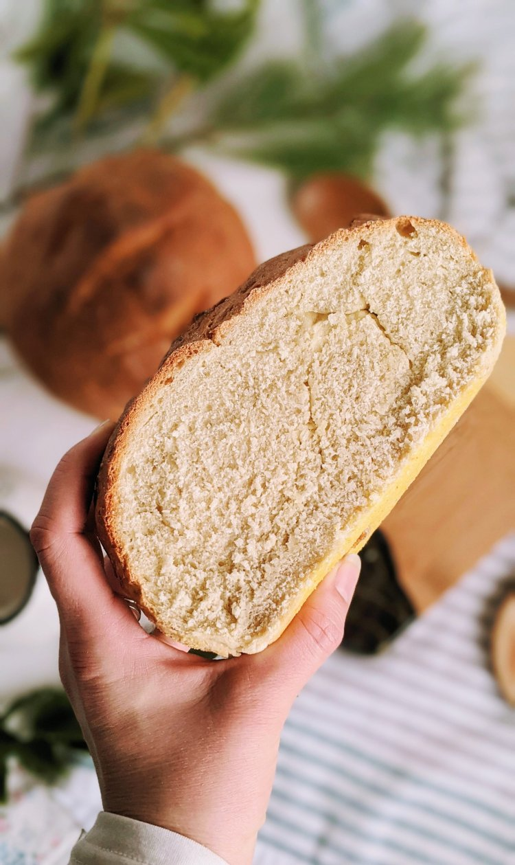 homemade bread recipe with cornmeal on the bottom vegan dairy free no eggs healthy plant based bread simple pantry staple ingredients cheap inexpensive
