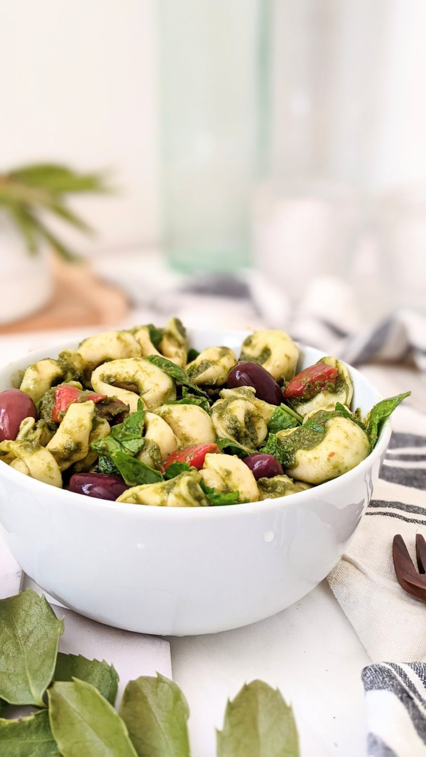 easy tortellini salad with cherry tomatoes healthy plant based pesto pasta salad with kalamata olives roasted red pepper and greek pesto dressing