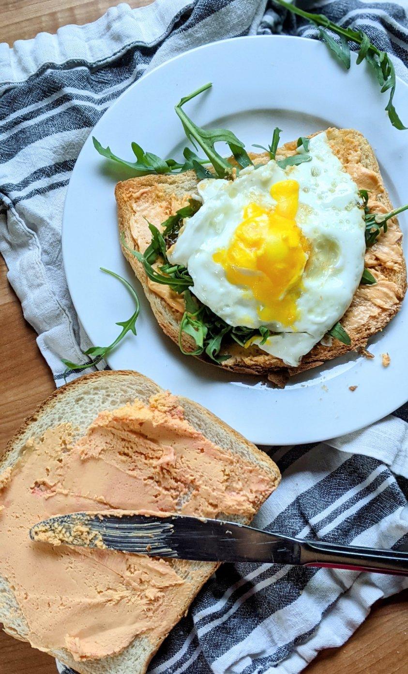 pub cheese breakfast sandwich with cheese spread recipe vegetarian charcuterie breakfast board sandwich healthy plant based breakfasts with spreadable cheese and eggs and arugula on brioche sliced recipe