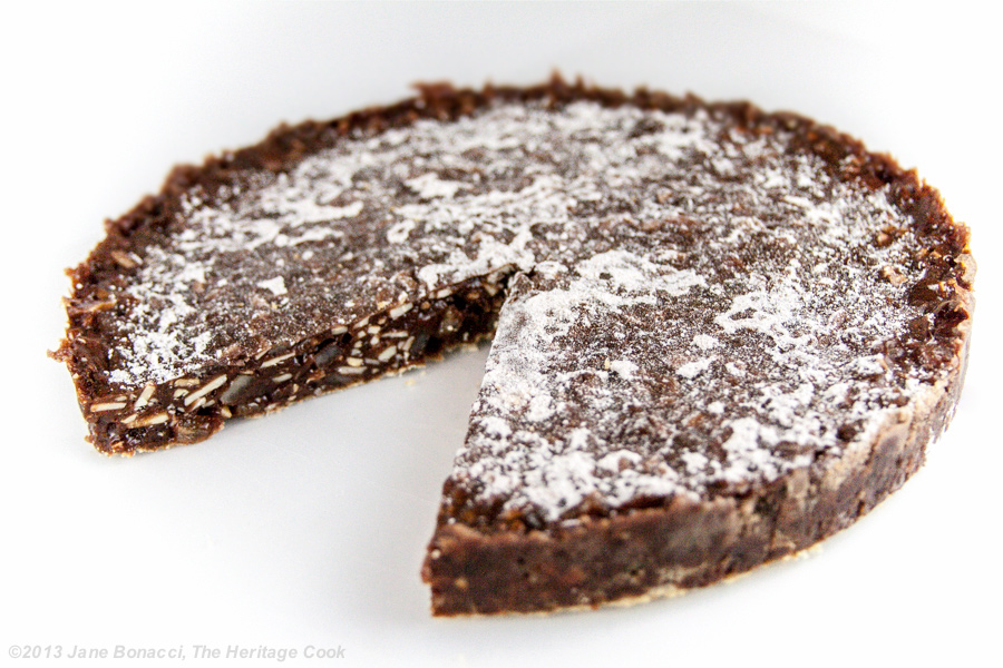 Chocolate Panforte from The Heritage Cook; a slice cut out of the whole cake