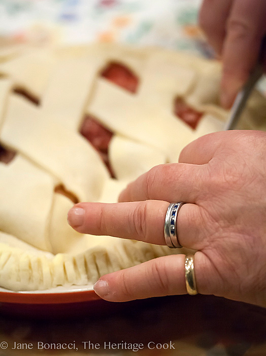 The hands of a master pie maker