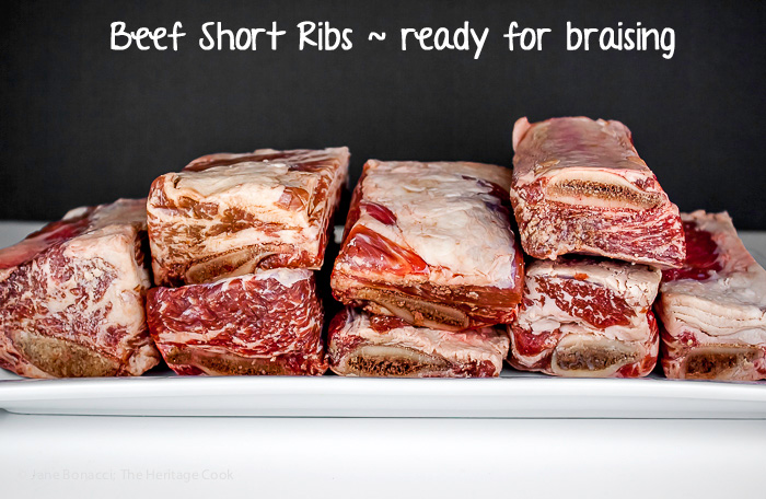tray of raw beef short ribs prior to braising