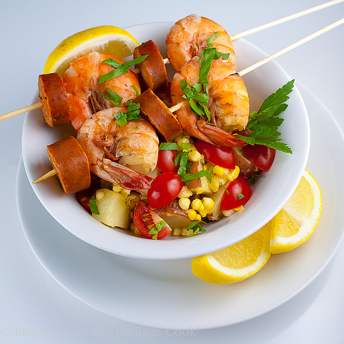 All the flavors of a traditional shrimp boil, but served on skewers over the classic corn and tomato Maque Choux - happiness in a bowl!
