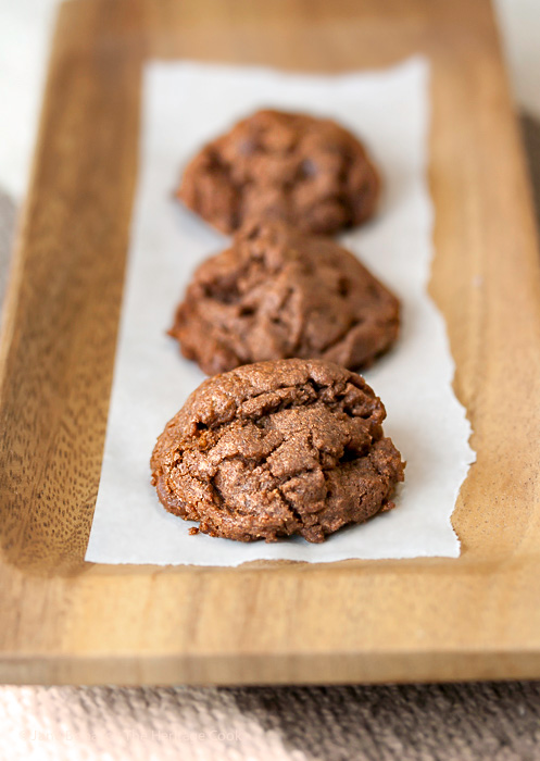 Three cookies lined up on wooden tray