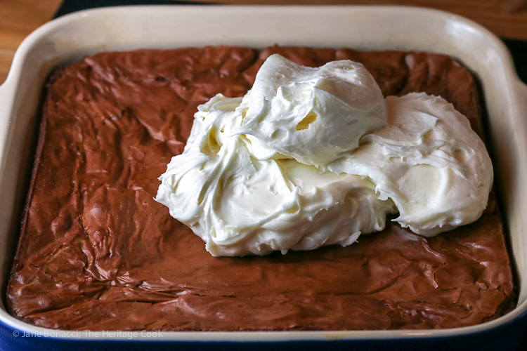 Creamy frosting ready to be spread over the brownies; Fudgy Nutella Brownies with Coconut Frosting; 2016 Jane Bonacci, The Heritage Cook