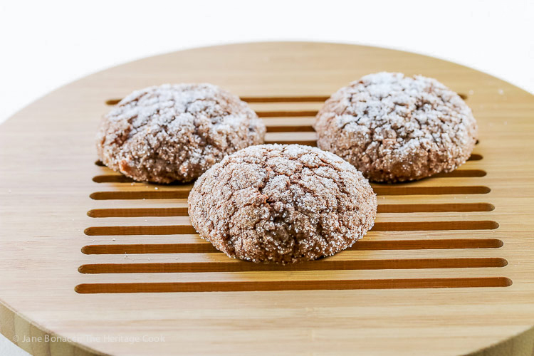 3 cookies on a wooden round cutting board; Dark Chocolate Bourbon Crackle Cookies © 2017 Jane Bonacci, The Heritage Cook