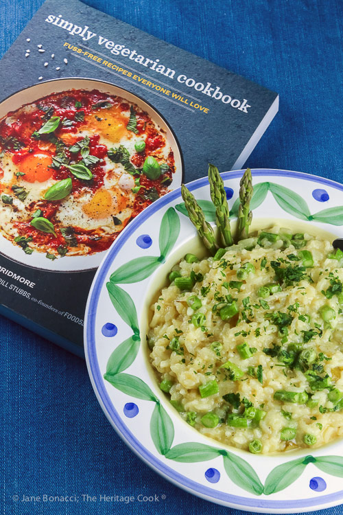 bowl of risotto with cookbook; Asparagus and Pea Risotto © 2018 Jane Bonacci, The Heritage Cook