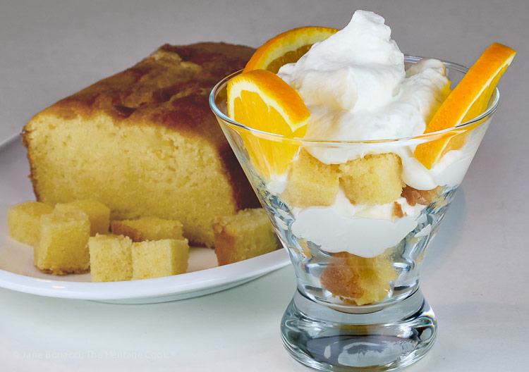 individual serving in glass container in front of pound cake; Orange Creamsicle Trifle; © 2018 Jane Bonacci, The Heritage Cook