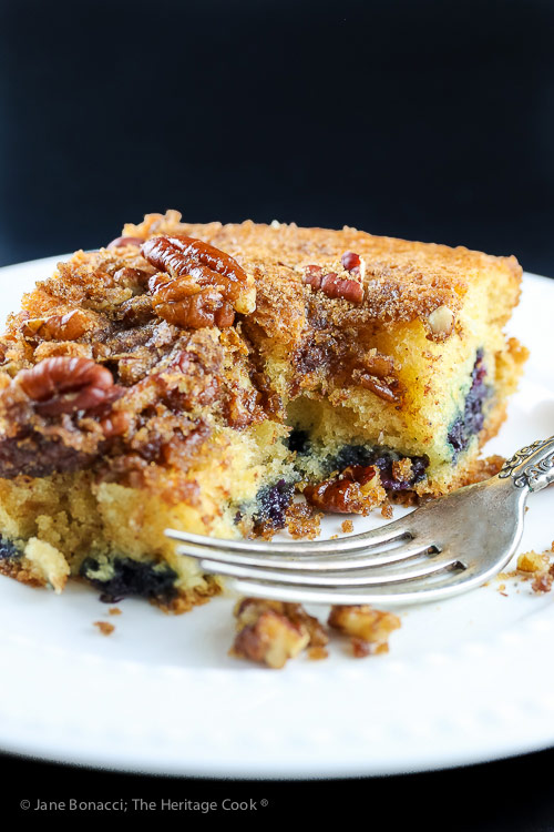 bite taken out of slice of coffee cake with fork on plate; Blueberry Coffee Cake © 2018 Jane Bonacci, The Heritage Cook