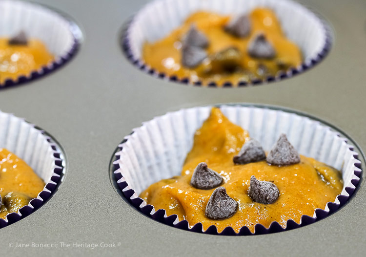 unbaked muffin batter in cups; Gluten-Free Chocolate Chip Pumpkin Muffins © 2018 Jane Bonacci, The Heritage Cook