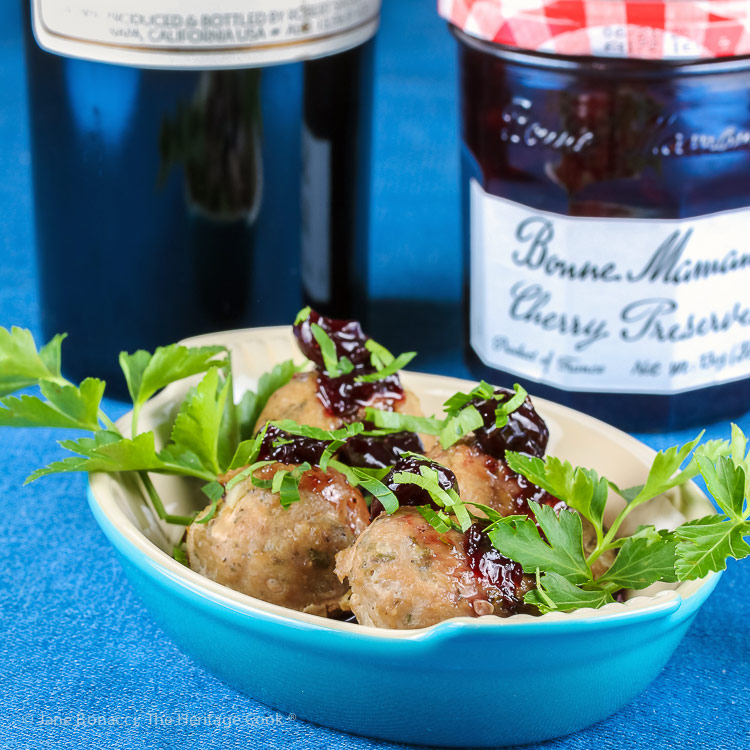Bowl of meatballs with jam and wine; Cherry Red Wine Baked Turkey Meatballs © 2019 Jane Bonacci, The Heritage Cook