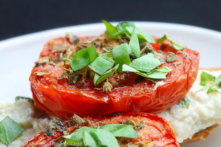 Close up of roasted tomato on the crostini