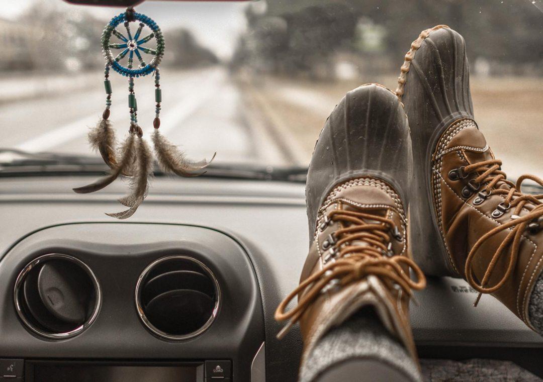rain boots on car dashboard