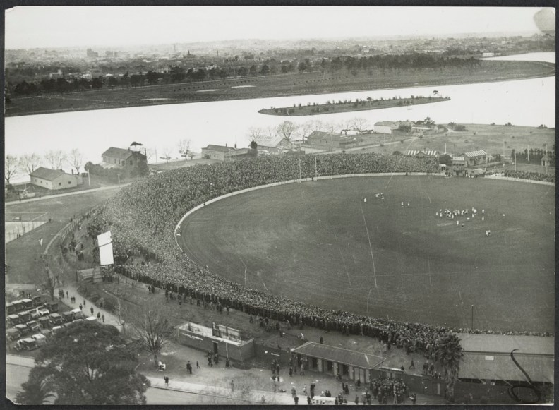 aerial_view_of_albert_park_lake_and_the_south_melbourne_cricket_ground_in_the_foreground_with_a_football_match_in_progress