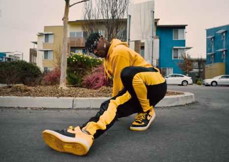young black breakdancer in trendy sportswear on street