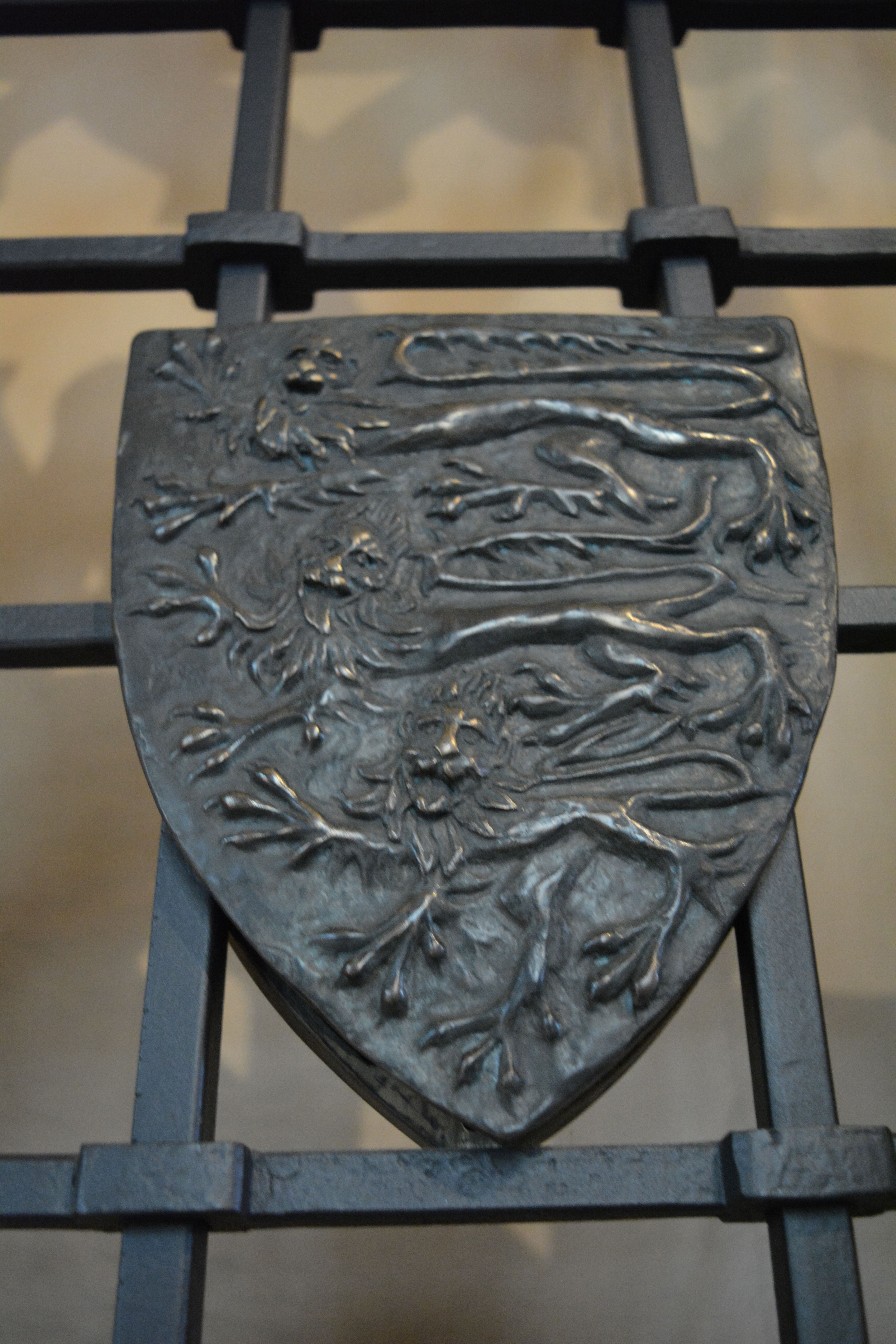 Detail from door grill leading to the vault where George Duke of Clarence and his wife Isobel Neville are buried in Tewkesbury Abbey.
