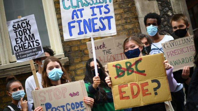 "People take part in a protest outside in London over the government""s handling of A-level results."