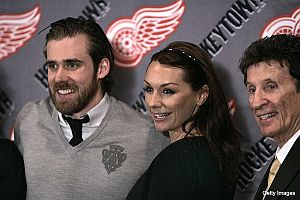 Henrik Zetterberg and Mike Ilitch of the Detroit Red Wings.