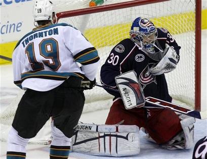 Blue Jackets goalie Dan LaCosta stops the Sharks Joe Thornton in overtime