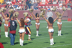 Redskins Clinton Portis 'Runs The Gauntlet' Of Cheerleaders {Photo: Flickr - C&R Dunn}