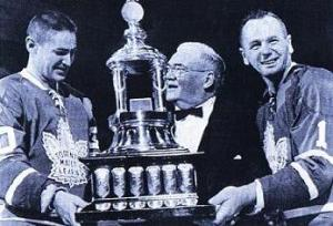 Bower and Sawchuk presented with the Vezina Trophy.