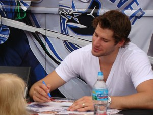 Ryan Kesler autographing posters even for the youngest of fans. (Monica McAlister)