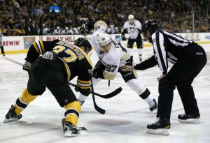 Sidney Crosby faces off against Patrice Bergeron. (Greg M. Cooper-USA TODAY Sports)