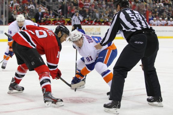 Travis Zajac gets set to battle John Tavares of the NY Islanders in the face-off circle. (Ed Mulholland-USA TODAY Sports)
