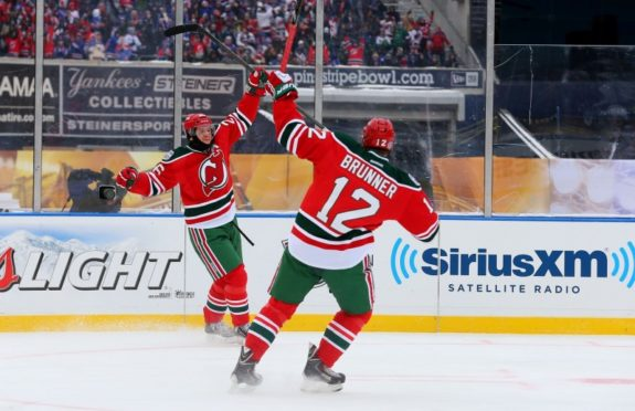 Patrik Elias & Damien Brunner celebrate a goal during the first period. (Ed Mulholland-USA TODAY Sports)