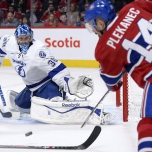 Montreal Canadiens forward Tomas Plekanec and Tampa Bay Lightning goalie Ben Bishop