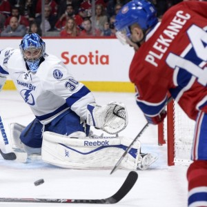 Montreal Canadiens forward Tomas Plekanec and Tampa Bay Lightning goalie Ben Bishop