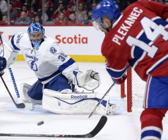Tomas Plekanec and ex-Tampa Bay Lightning goalie Ben Bishop