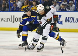 Jason Pominville fights off St. Louis Blues right wing T.J. Oshie during a game last April. The Wild won't have to deal with Oshie this season, but the Blues will still be a great opponent to watch. (Jasen Vinlove-USA TODAY Sports)