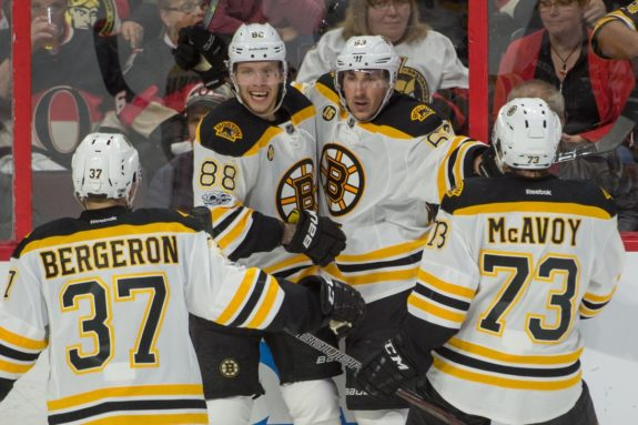 Brad Marchand celebrates with Bergeron, Pastrnak, and McAvoy