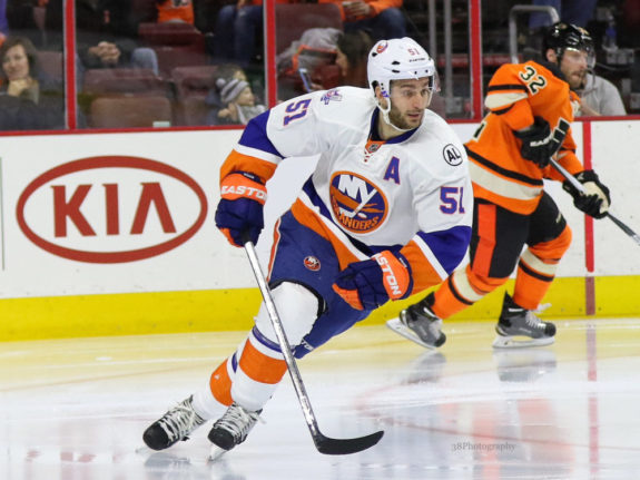 Hickey's OT goal helps Isles stay strong at home vs Flames