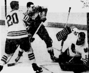 Red Wings Floyd Smith watches as team mate Ab Mcdonald's shot eludes Hawks goalie Glenn Hall.