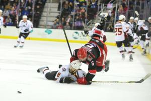 Aaron Palushaj (Cleveland Monsters) gets tangled up with Robbie Russo (Grand Rapids Griffins) photo credit : John Saraya