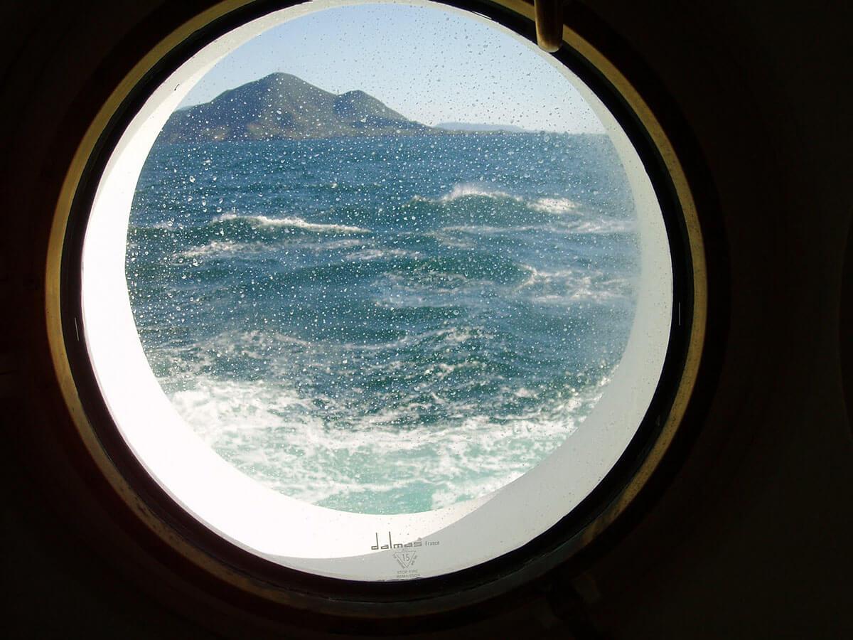 Enjoying the view through the porthole